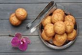 pic of tong  - Almond cookies with sugar tongs and orchid flower on rustic wooden table - JPG