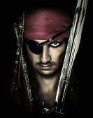Handsome Male Pirate Holding Sword