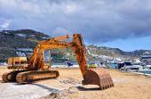 stock photo of oversize load  - excavator working on the construction Marine dock - JPG
