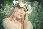 blue eyes blonde young woman summer portrait with wreath of flowers