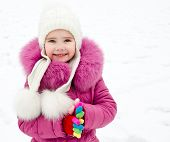 Portrait Of Smiling Little Girl In Winter Day