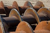 picture of auger  - Rusty earth auger on the ground in the sunshine - JPG