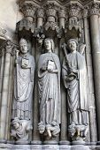 PARIS, FRANCE - NOV 11, 2012: Medieval Gothic statues on entry to Church of St-Germain-l'Auxerr ois