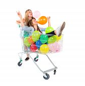 Girl With Many Balloons Inside Supermarket Cart Over White Background
