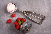 Ice Cream Scoop With Berry Ice Cream And Raspberry On Old Wooden Background