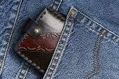 Leather wallet in a jeans pocket