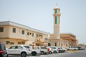 Ras Tanura, Saudi Arabia - May 10, 2014: Street View With Cars And Mosque Minaret, Saudi Arabia