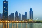 DUBAI, UAE - 1 APRIL 2014: Downtown of Dubai at dusk, UAE. Dubai is the most populous city in the Un