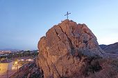 Christian Cross On Top Of A Rock