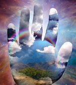 Landscape and clouds on hand and space Elements of this image furnished by NASA