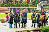 SAPA, VIETNAM - OCTOBER 29, 2012: Hmong women sell souvenirs in Sapa. The Hmongs are known for their