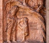 PARMA,ITALY-MAY 01,2014:Christ Performing Works of Mercy relief at the baptistry from Benedetto Antelami. Baptistery in Parma is considered to be among the most important Medieval monuments in Europe.
