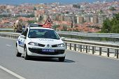 MARMARIS, TURKEY - MAY 1, 2014: Police car on the highway. Policemen check the road  before the star