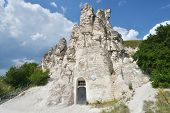DIVNOGORIE, VORONEZH REGION, RUSSIA - JUNE 8, 2014: People near the cave church of Sicilian Icon of