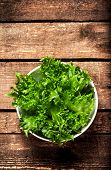 Fresh Green Salad In A Bowl On  Wooden Background - Lettuce Salad Background With Copyspace. Healthy