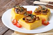 Polenta With Mushrooms, Tomatoes And Thyme On The Table