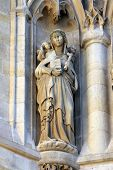 PARIS, FRANCE - NOV 06, 2012: Statue of Saint, St-Jacques Tower is 52-meters (171 ft) Flamboyant Got
