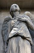 PARIS, FRANCE - NOV 09, 2012: Archangel Michael, architectural details of Eglise de la Madeleine. Ma