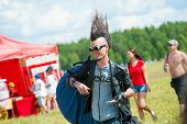 BIG ZAVIDOVO, RUSSIA - JULY 4: People attend open-air rock festival
