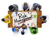 People in a Meeting and Risk Management Concepts