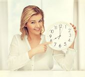 picture of woman in casual clothes with clock