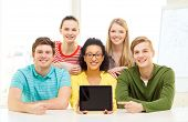 education, technology and college concept - five smiling students showing tablet pc computer blank s