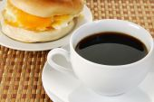 Cup Of Coffee And A Bagel Sandwich