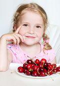 Cute Little Girl Eating Cherries