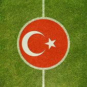 Football field center closeup with Turkish flag in circle
