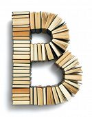 Letter B formed from the page ends of closed vintage hardcover books standing on a white background from a set or series of numbers