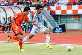 Sisaket Thailand-july 6: Theerachai Ngamcharoen Of Chainat Hornbill Fc. (white) In Action During Tha