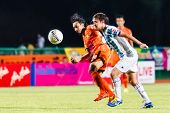 Sisaket Thailand-july 6: Somsak Wongyai Of Sisaket Fc. (orange) In Action During Thai Premier League