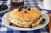 stock photo of buttermilk  - Buttermilk pancakes with blueberries on a picnic table - JPG