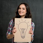 Young Happy Woman Holding Placard With Lightbulb Drawn On It