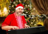 Cheerful Santa Claus Playing Piano And Singing
