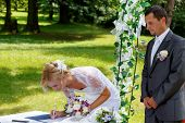 Beautiful Blonde Smiling Bride Signed Contract