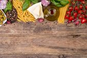 Italian food ingredients on wooden background with copy space