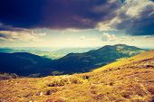 Mountain landscape with dramatic overcast sky. National Park Carpathian, Ukraine, Europe. Beauty wor