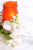 Bright icon-lamp with flowers on wooden background