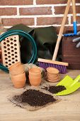 Tools of gardener on  bricks background