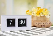 Alarm clock on table, on light background