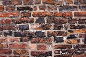 Old brick wall texture. Fragment of medieval wall in Gdansk, Poland. Architectural background.