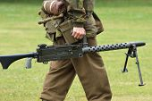 Soldier carrying machine gun