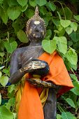 Thai Monk Statue In Temple Holding Alms Bowl