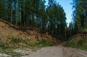 foto of ravines  - road leading through a ravine to the river - JPG
