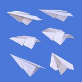 Paper airplanes over blue background