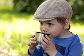 Boy Drinking Tea Outdoor