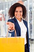 Afro Woman Holding Shopping Bags