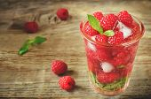 Summer Juice With Fresh Raspberries Mint And Ice In A Glass