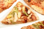 stock photo of doughy  - Multigrain crust pizza with different types of toppings like chicken green peppers and pineapple - JPG
